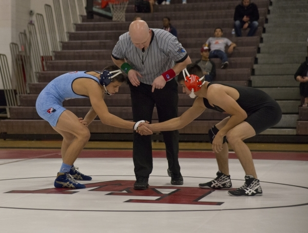 Centennial's Nico Antuna, left, shakes hands with Chaparral's Julio Bravo during a quad meet between Chaparral, Las Vegas, Palo Verde and Centennial inside the Las Vegas High School gy ...