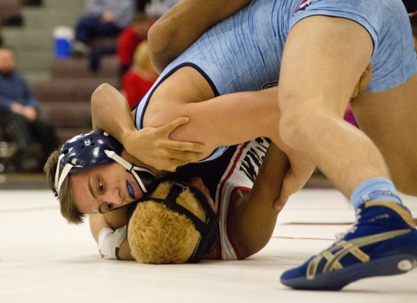 Centennial's Nico Antuna, top, wrestles Las Vegas' Aaron Najera during a quad meet between Chaparral, Las Vegas, Palo Verde and Centennial inside the Las Vegas High School gymnasium on ...