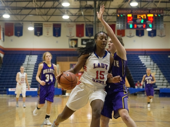 Bishop Gorman's Madison Washington (15) works the ball around Abigail Moerkerke (3) of Campbell County (Wyo.) during the fourth annual Tarkanian Classic basketball tournament girl's ch ...