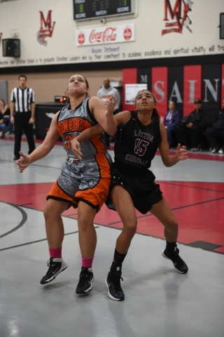 Chaparral's Sierra Shaw (32), left, battles Utah's Layton Christian Felicia Marshall (15) during the championship game of the Vegas Invitational girls basketball tournament at the Moun ...
