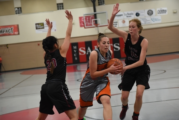 Chaparral's Alexis Vanstory (24) drives the ball against Utah's Layton Christian defenders from left, Lovisa Humla (20) and Lily Henry (10) during the championship game of the Vegas In ...