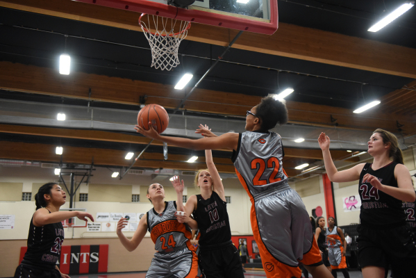 Chaparral's Jade Hazelton (22) goes up for a shot against Utah's Layton Christian defenders from left, Lovisa Humla (20), Lily Henry (10), and Kylie Goodwin (24) during the championshi ...