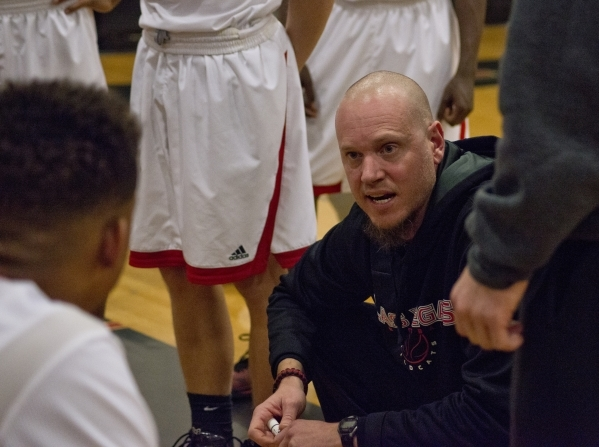 Las Vegas High School head coach Jason Wilson speaks with his team during their game against Rancho High School during the Las Vegas Prep Championship basketball tournament at Las Vegas High Schoo ...