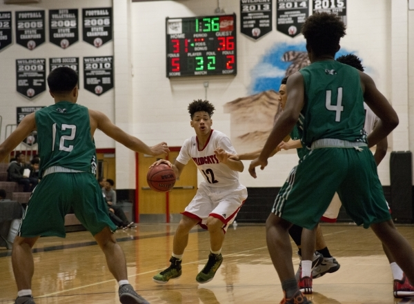 Las Vegas' Donovan Joyner (12) works the ball up the court  during their game against Rancho High School during the Las Vegas Prep Championship basketball tournament at Las Vegas High School ...