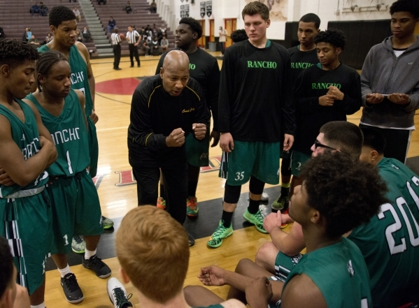 Rancho High School head coach Ronald Childress speaks with his team during their game against Las Vegas High School during the Las Vegas Prep Championship basketball tournament at Las Vegas High S ...