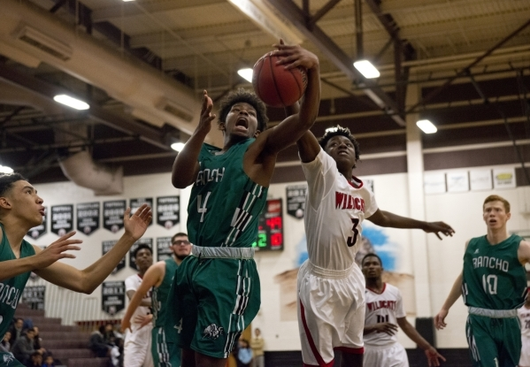 Rancho's Stepfon Cotton-Taylor (4) and Las Vegas' Ronald Daniels (3) battle for possession of the ball during the final seconds of their game during the Las Vegas Prep Championship bas ...