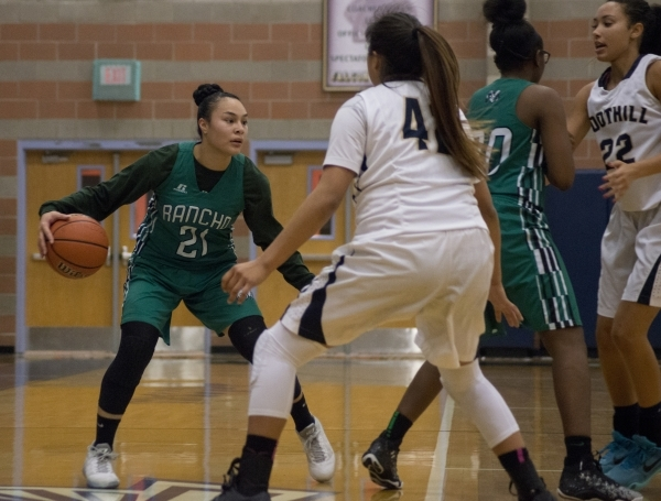 Rancho's Tatianna Lee (21) looks to get the ball past Foothillís Trinity Betoney (42) during their game at Foothill High School in Henderson on Tuesday, Jan. 5, 2016. Foothill won the gam ...