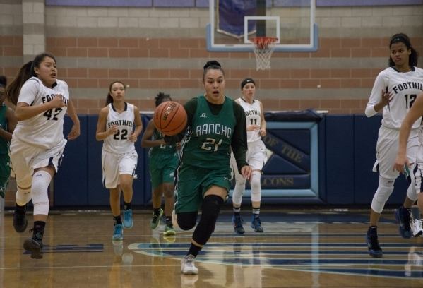 Rancho's Tatianna Lee (21) takes the ball up the court during their game at Foothill High School in Henderson on Tuesday, Jan. 5, 2016. Foothill won the game 48-41. Daniel Clark/Las Vegas Re ...