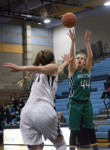 Rancho's Samantha Pochop (44) takes a shot over  Foothillís Kylie Vint (11) during their game at Foothill High School in Henderson on Tuesday, Jan. 5, 2016. Foothill won the game 48-41. D ...