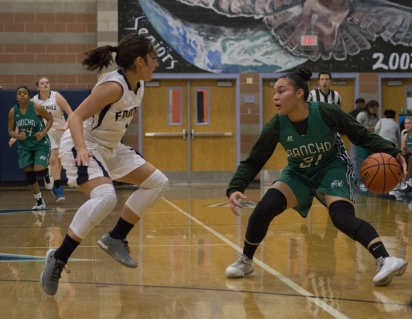 Rancho's Tatianna Lee (21) faces off against Foothillís Amanda Carducci (1) during their game at Foothill High School in Henderson on Tuesday, Jan. 5, 2016. Foothill won the game 48-41. D ...