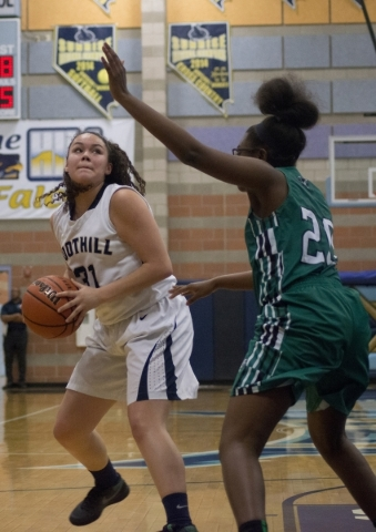 Foothillís Bri Rosales (31) looks to take a shot at the basket as Rancho's Ashlynn McCall (20) defends during their game at Foothill High School in Henderson on Tuesday, Jan. 5, 2016. Foo ...