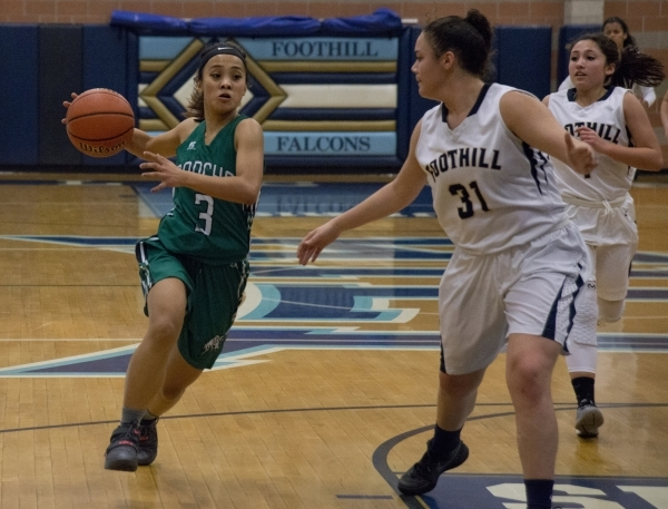 Rancho's Maureen Macato (3) looks to move the ball past Foothillís Bri Rosales (31) during their game at Foothill High School in Henderson on Tuesday, Jan. 5, 2016. Foothill won the game  ...