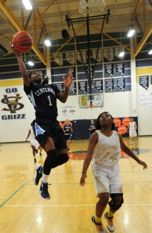 Centennial guard Pam Wilmore scores on a fast break layup in front of Spring Valley guard Kayynn Lesley (24) in the first quarter of their prep girl's basketball game at Spring Valley High S ...