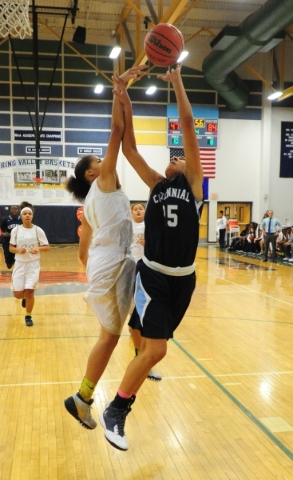 Centennial guard Samantha Thomas (25) goes up for a shot against Spring Valley guard Kayla Harris (11) in the fourth quarter of their prep girl's basketball game at Spring Valley High School ...