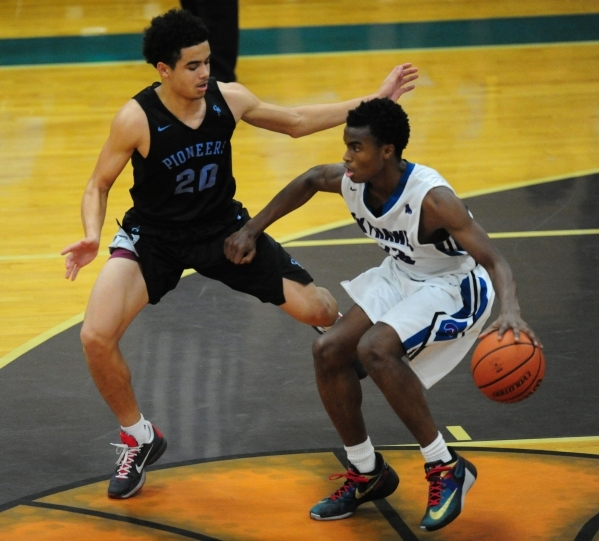 Canyon Springs forward Joseph Haulcy (20) defends Silverado guard Errol Newman (23) in the backcourt in the fourth quarter of their prep basketball game at Silverado High School in Las Vegas Wedne ...