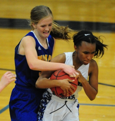 Moapa Valley guard Kinlee Marshall, left, and Desert Pines guard Chrystian Myles fight for control of the ball in the fourth quarter of their prep basketball game at Desert Pines High School in La ...