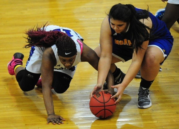 Desert Pines forward See'Airrah Evans-Collins, left, and Moapa Valley center Kaila Enosa dive for a loose ball in the fourth quarter of their prep basketball game at Desert Pines High School ...