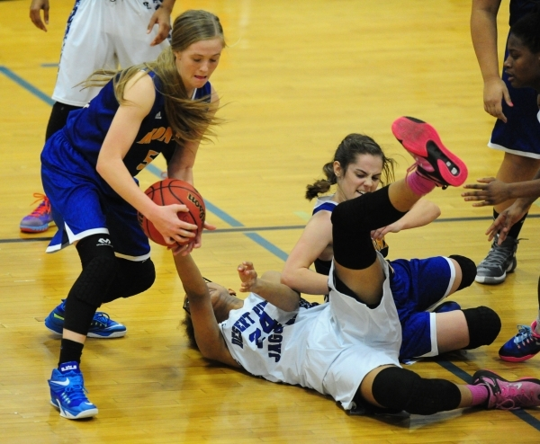 Moapa Valley guard Kinlee Marshall, left, steals the ball from Desert Pines center Brianna Fitzgerald (24) while Matilda Thompson, right, looks on in the third quarter of their prep basketball gam ...