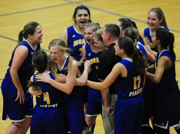 Moapa Valley players celebrate their come from behind victory over Desert Pines during their prep basketball game at Desert Pines High School in Las Vegas Thursday, Jan. 21, 2016. Moapa won 32-31. ...
