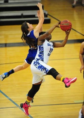 Desert Pines forward See'Airrah Evans-Collins, right, and Moapa Valley guard Madison Bush collide while Evans-Collins catches a pass in the fourth quarter of their prep basketball game at De ...