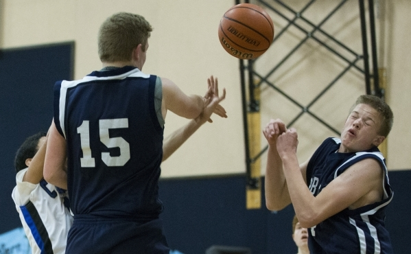White Pine's Collin Young (4) reacts to a ball moving toward him in the boy's basketball game against Cavalry Chapel at Calvary Chapel Christian School on Saturday, Jan. 30, 2016, in L ...