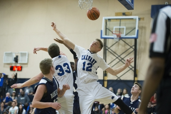 Cavalry Chapel's Alec Neider (12) and James Gentile (33) jump for a rebound in the boy's basketball game against White Pine at Calvary Chapel Christian School on Saturday, Jan. 30, 201 ...