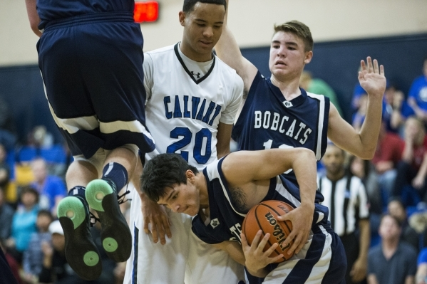 White Pine's Dakoda Barela (23) grabs procession of the ball in the boy's basketball game against Cavalry Chapel at Calvary Chapel Christian School on Saturday, Jan. 30, 2016, in Las V ...