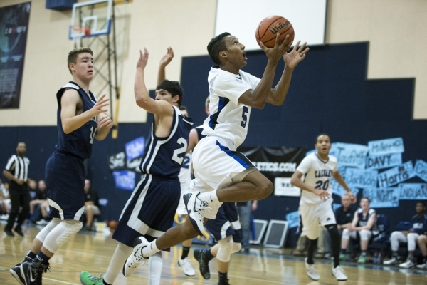 Calvary Chapel's Quentin Hank (5) goes up for a shot in the boy's basketball game against White Pine at Calvary Chapel Christian School on Saturday, Jan. 30, 2016, in Las Vegas. Calvar ...