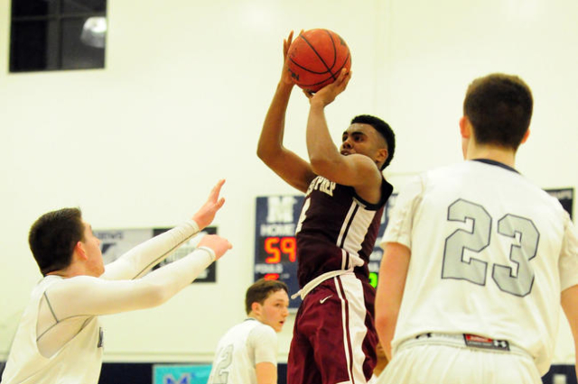 Agassi Prep forward Daniel Plummer (4) makes the game winning field goal with seconds remaining in the fourth quarter of their prep basketball game at The Meadows School in Las Vegas Friday, Feb.  ...