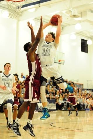 The Meadows guard Ethan Fridman (12) goes up for a shot against Agassi Prep guard Stephan Laushaul in the first quarter of their prep basketball game at The Meadows School in Las Vegas Friday, Feb ...