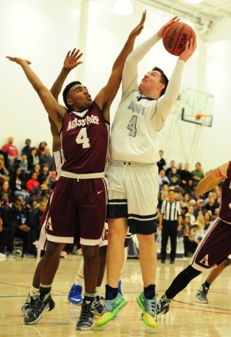 The Meadows forward Joe Epstein goes up for a shot against Agassi Prep forward Daniel Plummer in the first quarter of their prep basketball game at The Meadows School in Las Vegas Friday, Feb. 5,  ...