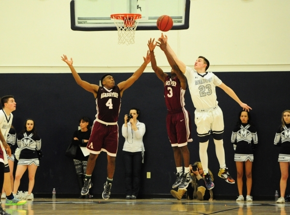 Agassi Prep forward Daniel Plummer (4), guard Stephan Laushaul (3), and The Meadows guard Jake Epstein (23) go up for a rebound in the third quarter of their prep basketball game at The Meadows Sc ...