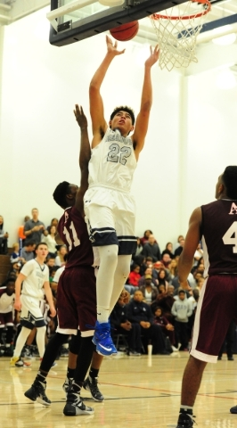 The Meadows center Max Hisatake (22) goes up for a shot against Agassi Prep forward Jared Holmes (11) in the second quarter of their prep basketball game at The Meadows School in Las Vegas Friday, ...