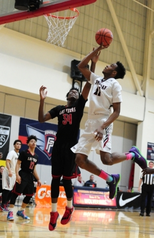 Findlay Prep guard Oshae Brissett (11) goes up for a shot against Las Vegas wing Marquise Raybon (34) in the first quarter of their prep basketball game at the Henderson International School in La ...