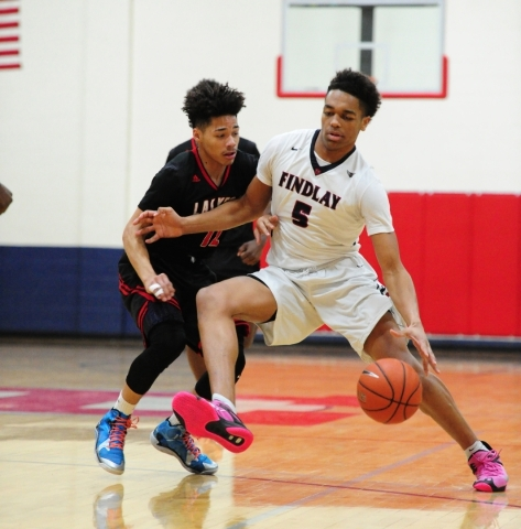 Findlay Prep guard P.J. Washington (5) dribbles the ball up-court while Las Vegas guard Donovan Joyner (12) defends in the first quarter of their prep basketball game at the Henderson Internationa ...
