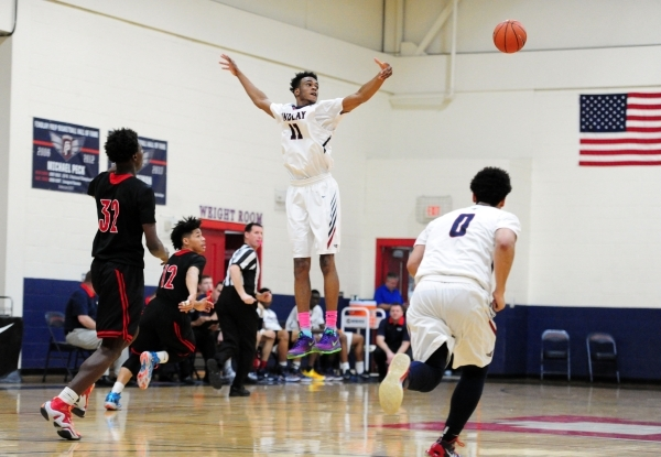 Findlay Prep guard Oshae Brissett attempts to intercept Las Vegas guard Dartanion Myers' (32)transition pass in the first quarter of their prep basketball game at the Henderson International ...