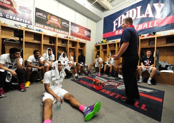 Findlay Prep head coach Andy Johnson addresses his team during halftime of their prep basketball game against Las Vegas at the Henderson International School in Las Vegas Saturday, Feb. 6, 2016. F ...