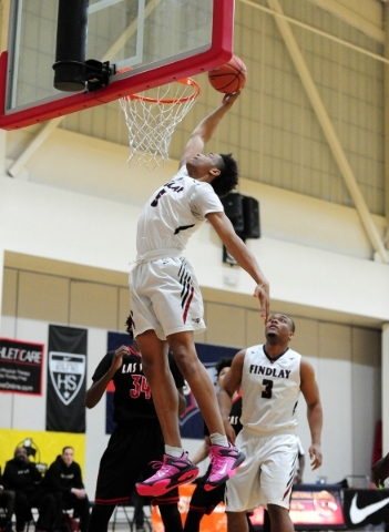 Findlay Prep guard P.J. Washington dunks against Las Vegas High on the first drive of the game in the first quarter of their prep basketball game at the Henderson International School in Las Vegas ...