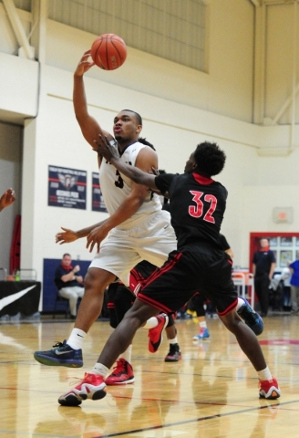 Findlay Prep guard Carlos Johnson (3) passes in front of Las Vegas guard Dartanion Myers (32) in the first quarter of their prep basketball game at the Henderson International School in Las Vegas  ...