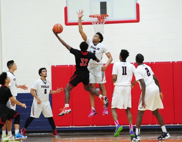 Las Vegas guard Dartanion Myers goes up for a shot against Findlay Prep guard P.J. Washington (5) in the second quarter of their prep basketball game at the Henderson International School in Las V ...