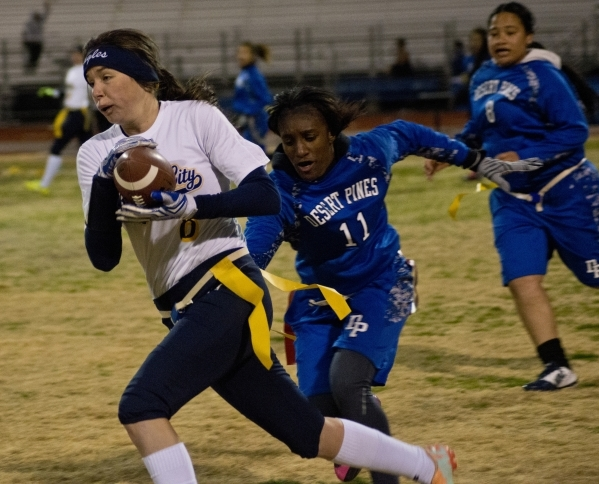 Boulder City'­s Oshanna Remy (8) outruns Desert Pines' Tanaiya Hinton (11) during their game at Desert Pines High School In Las Vegas on Monday, Feb. 1, 2016. Boulder City won the gam ...