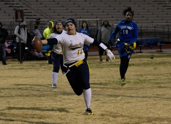 Boulder City quarterback Jeanne Carmell (14) extends the ball for a touchdown during their game against Desert Pines at Desert Pines High School in Las Vegas on Monday, Feb. 1, 2016. Boulder City  ...