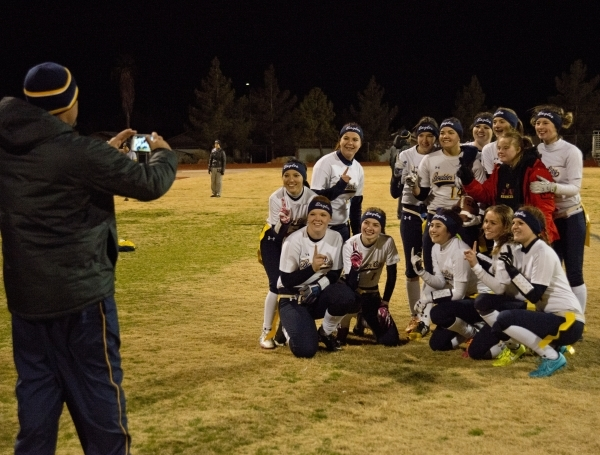 Boulder City High School flag football head coach Chris Morelli takes a photo of his team after their win against Desert Pines at Desert Pines High School in Las Vegas on Monday, Feb. 1, 2016. Bou ...