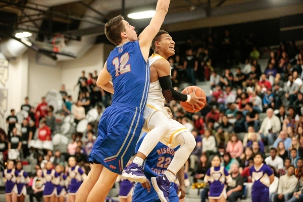 Durango junior Demetrius Valdez (13) leaps for the basket as Bishop Gorman senior Zach Collins (12) defends during a prep basketball game at Durango High School in Las Vegas Friday, Feb. 12, 2016. ...