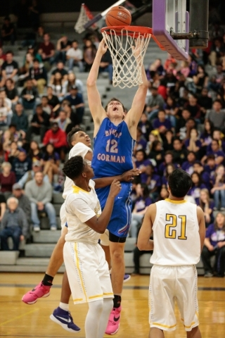 Bishop Gorman senior Zach Collins (12) center shoots a basket while surrounded by Durango defenders during a prep basketball game at Durango High School in Las Vegas Friday, Feb. 12, 2016. Bishop  ...