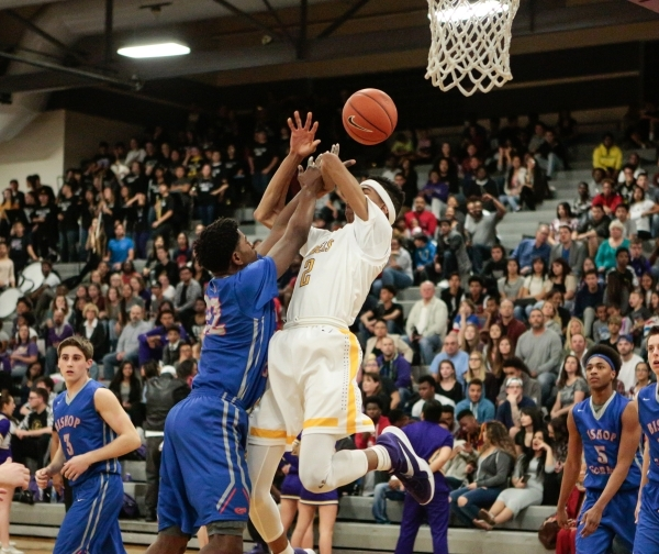 Bishop Gorman junior Christian Popoola (22) shoots a basket while Durango senior Michael Diggins (2) attempts to block the shot during a prep basketball game at Durango High School in Las Vegas Fr ...