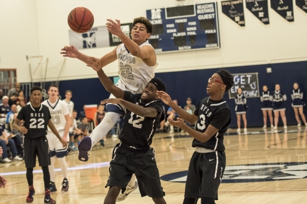 Meadows Mustangs center Max Hisatake (22) reaches for a ball over the head of Mountain View Saints forward Bernard Williams (12) at The Meadows School in Las Vegas on Saturday, Feb. 13, 2016. Josh ...