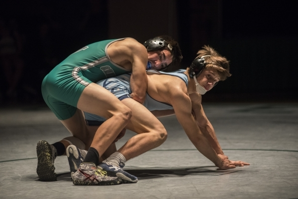 Green Valley's Desmond Bowers, top, wrestles Foothill's Kohl Velado during their 126 lbs. championship match at the Division 1 Sunrise Region wrestling meet at the Green Valley high sc ...