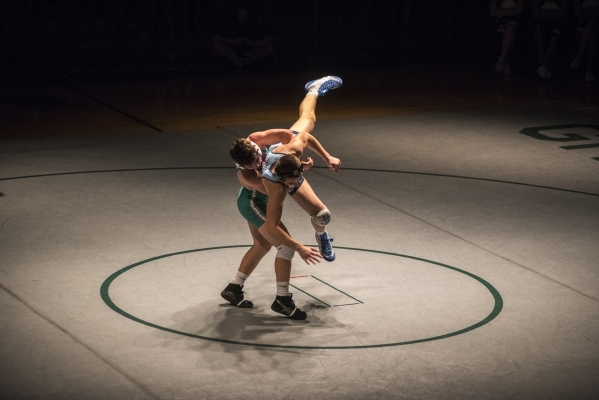 Green Valley's Cody Chamberlin, left, wrestles Foothill's Wyatt English during their 138 lbs. championship match at the Division 1 Sunrise Region wrestling meet at the Green Valley hig ...