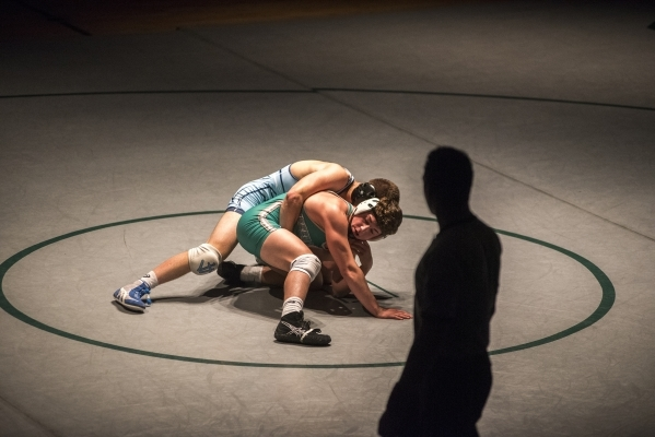 Foothill's Wyatt English, top, wrestles Green Valley's Cody Chamberlin during their 138 lbs. championship match at the Division 1 Sunrise Region wrestling meet at the Green Valley high ...